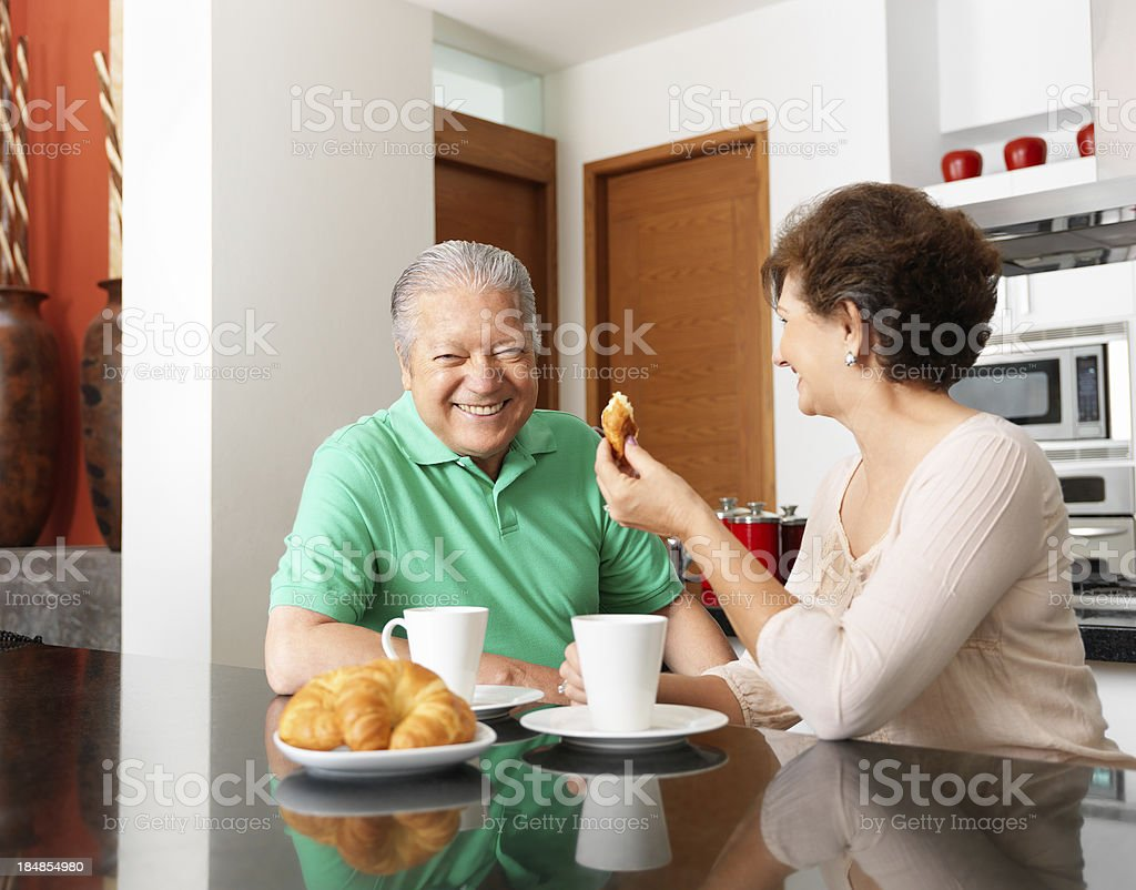 Happy senior couple drinking coffee royalty-free stock photo