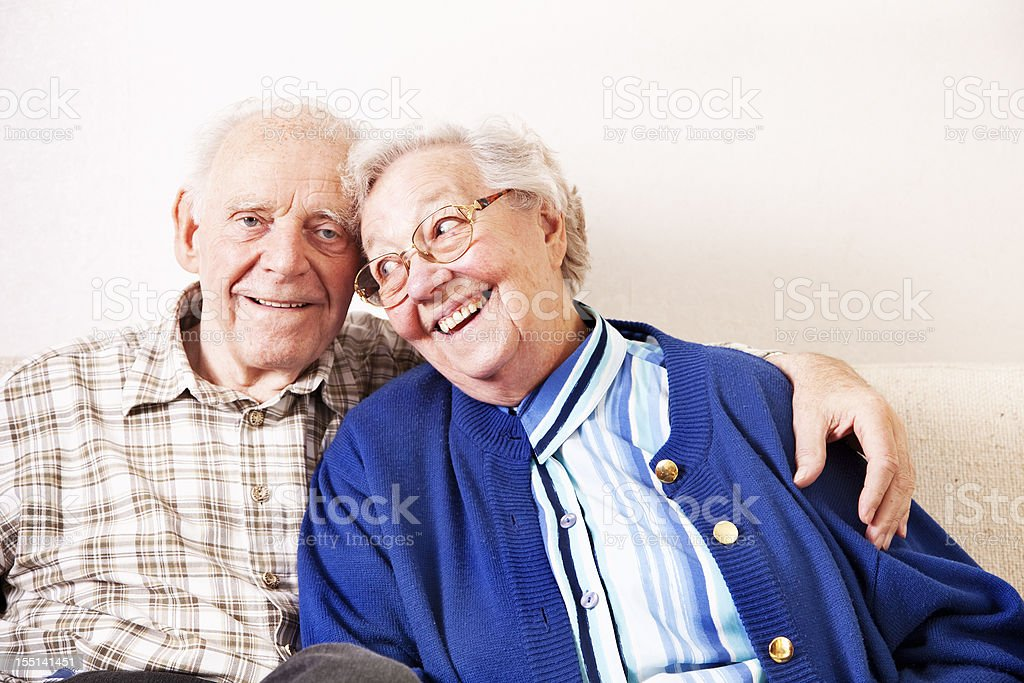 happy senior couple embracing royalty-free stock photo