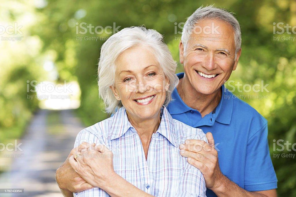 Happy Senior Couple Embracing stock photo