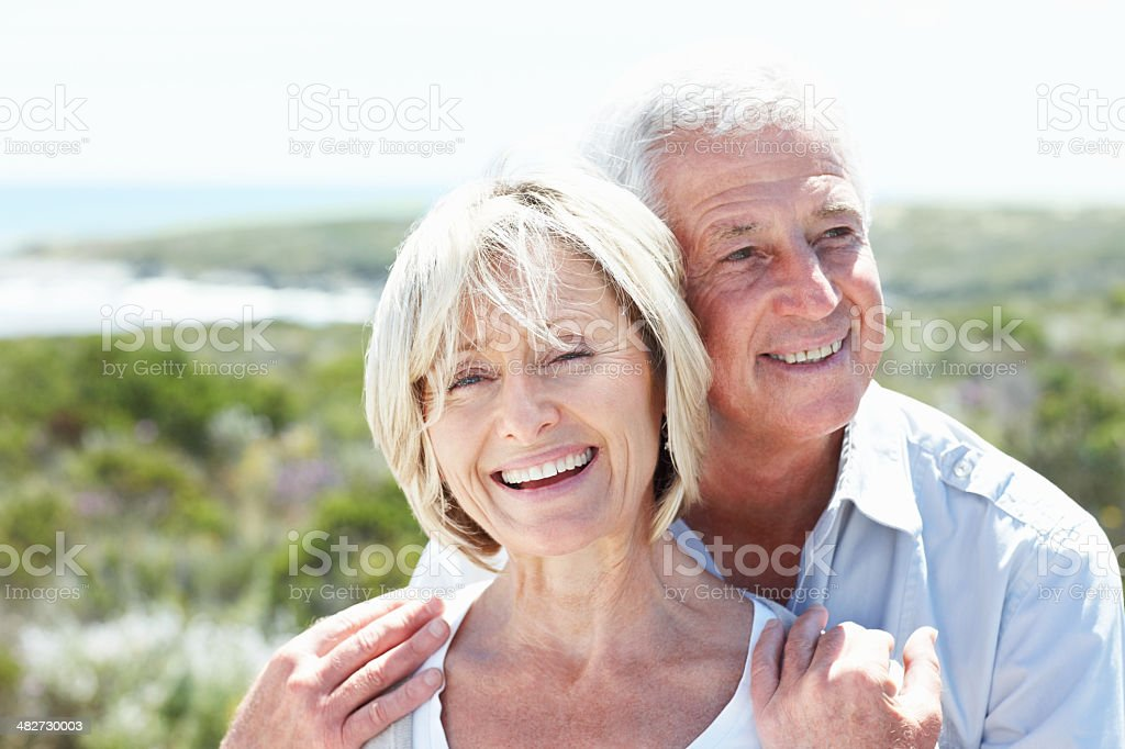 Happy senior couple enjoying themselves in love royalty-free stock photo