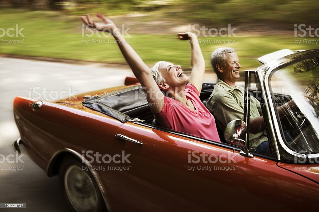 Happy Senior Couple Going For a Drive stock photo