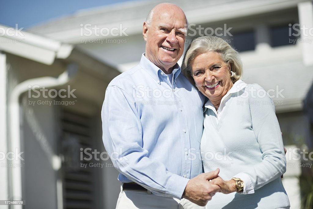 Happy Senior Couple Holding Hands royalty-free stock photo