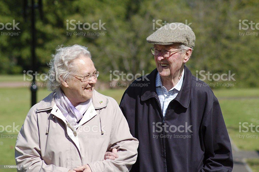 Happy senior couple in park royalty-free stock photo