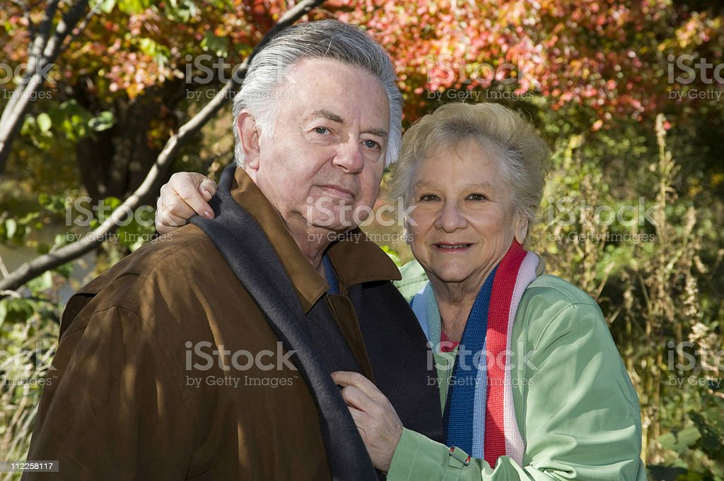 Happy senior couple in the park autumn royalty-free stock photo