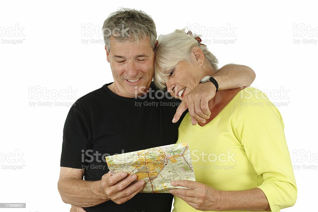 Happy senior couple looking at map isolated on white royalty-free stock photo