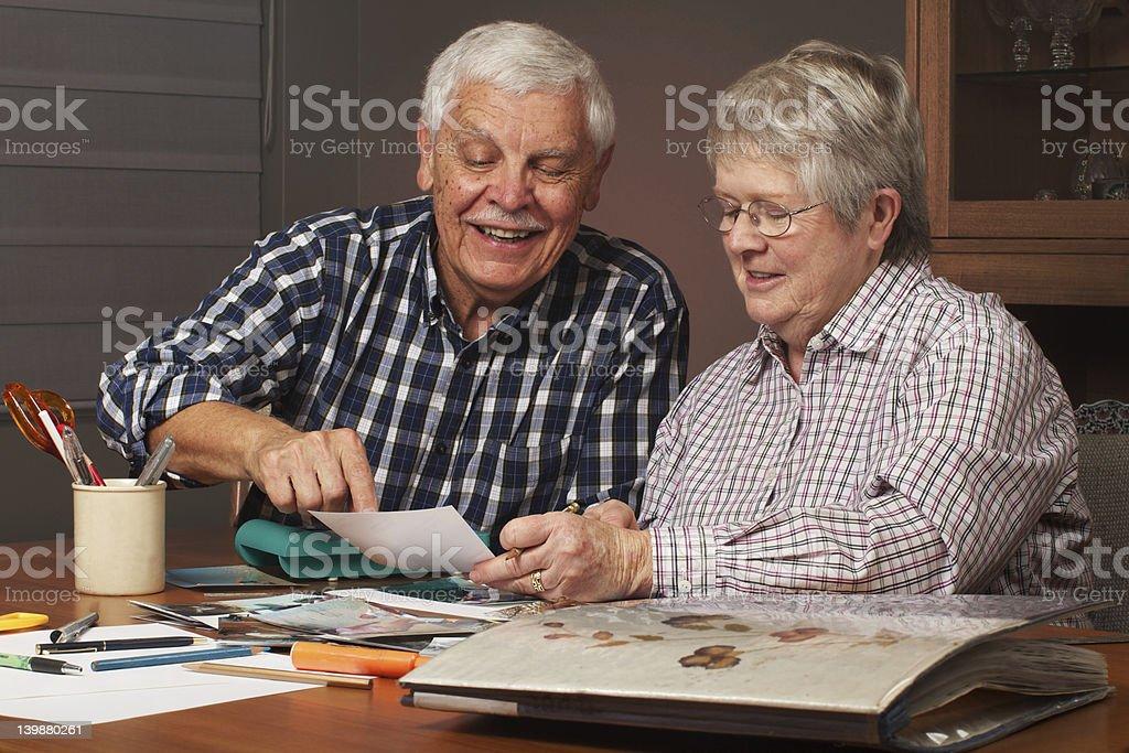 Happy senior couple making a scrapbook stock photo