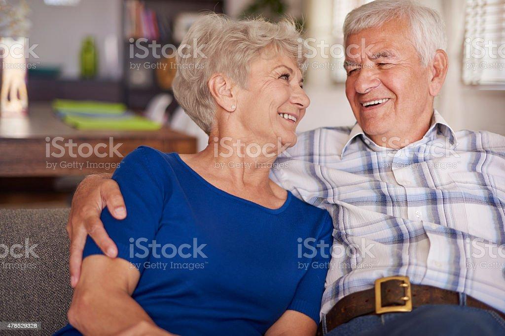 Happy senior couple on te sofa stock photo