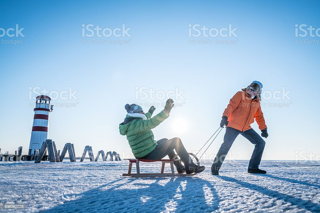 happy senior couple outdoors on cold winters day stock photo
