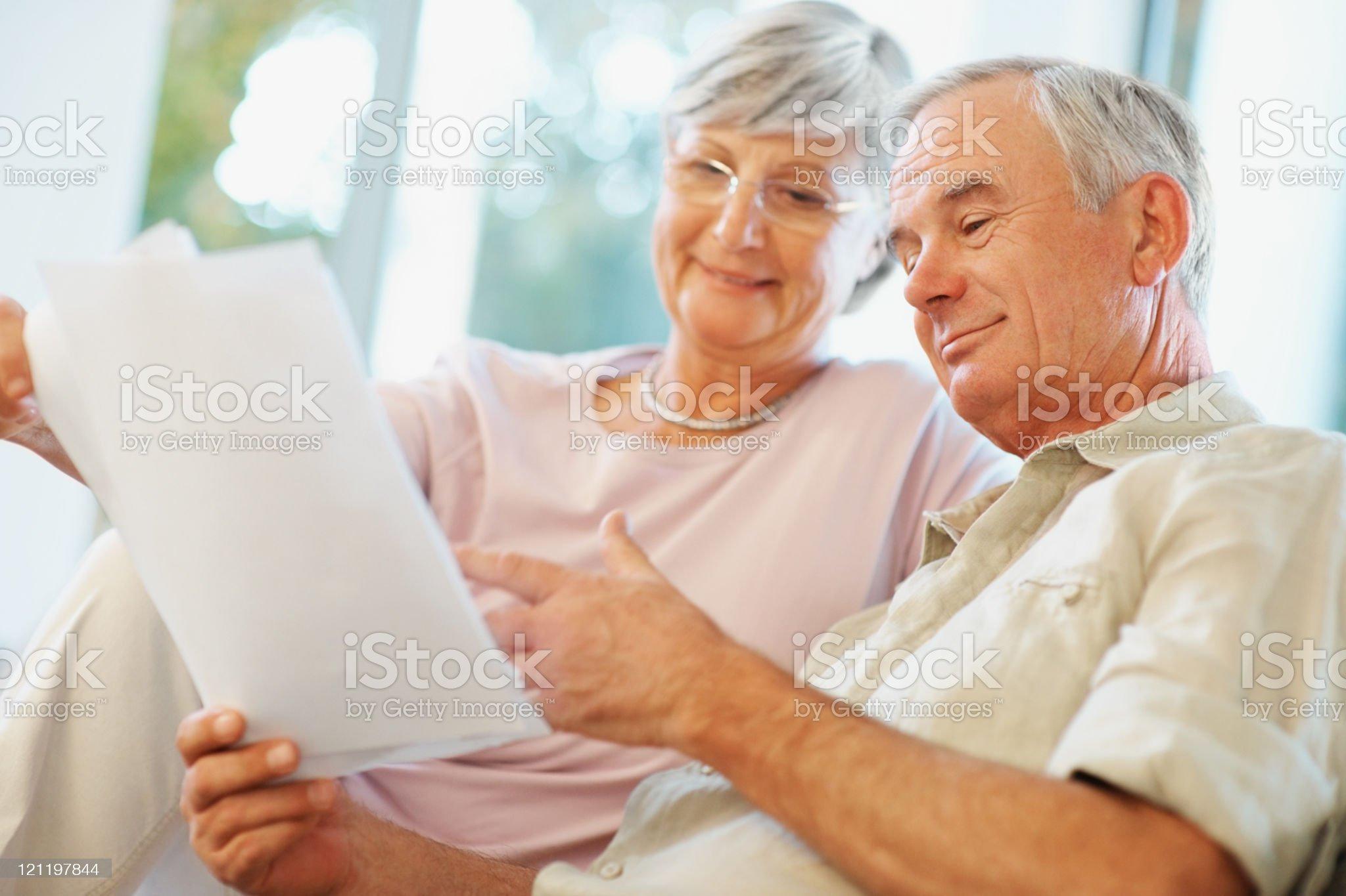 Happy senior couple planning for retirement royalty-free stock photo
