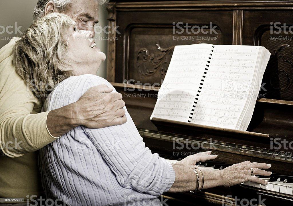 Happy Senior Couple Playing the Piano stock photo