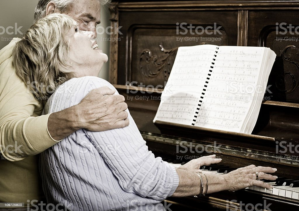 Happy Senior Couple Playing the Piano stock photo