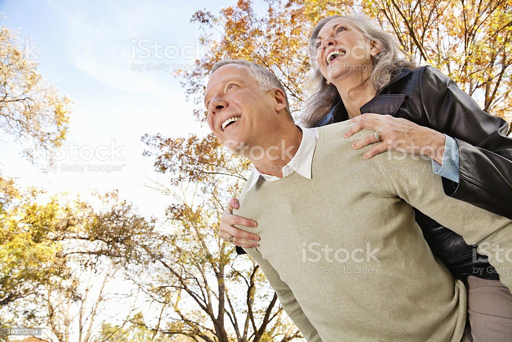 Happy Senior Couple Playing Together Outdoors royalty-free stock photo