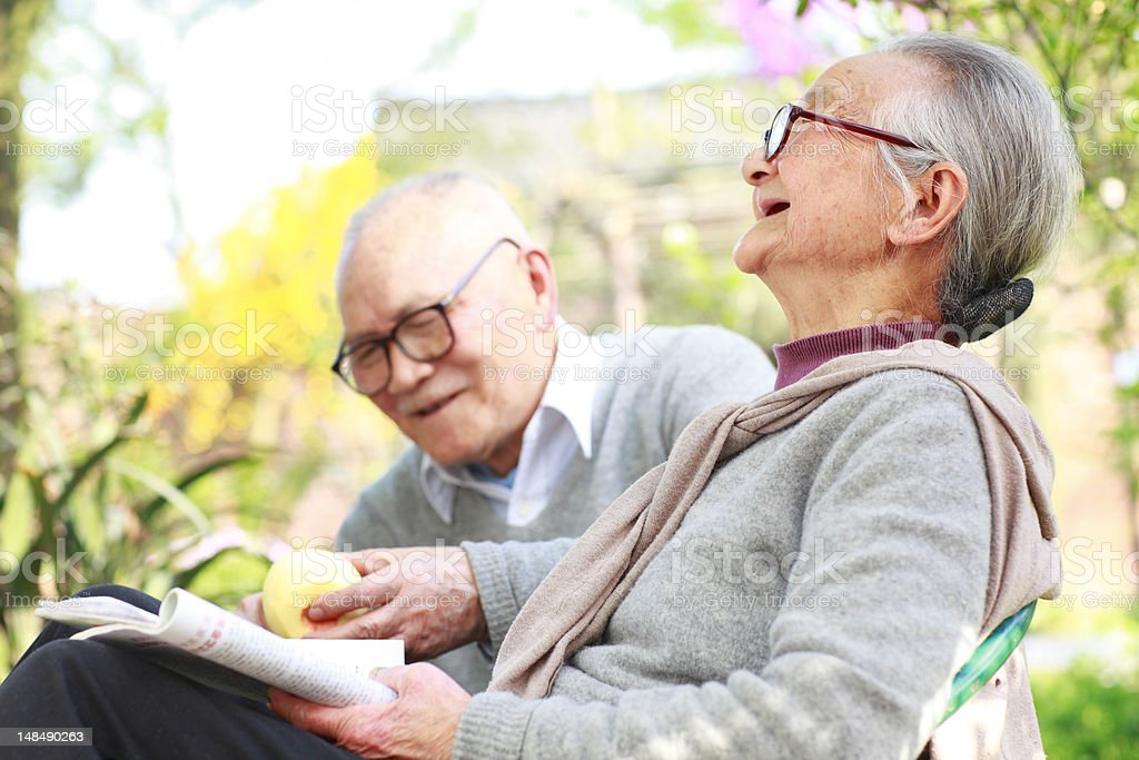 happy senior couple relax in the garden royalty-free stock photo