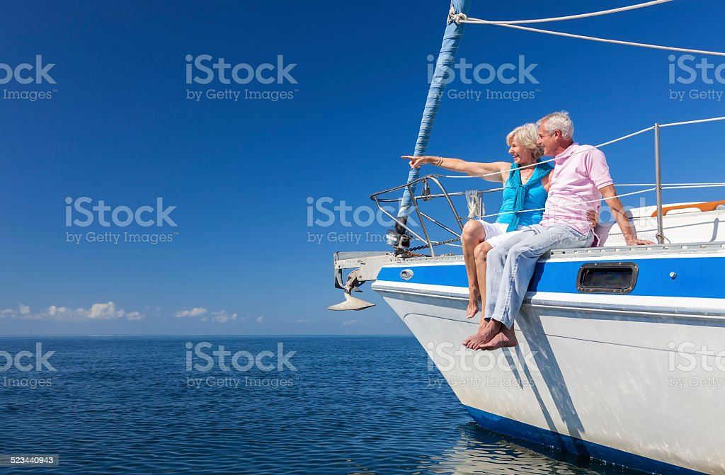Happy Senior Couple Sailing on a Sail Boat stock photo