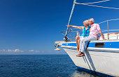Happy Senior Couple Sailing on a Sail Boat