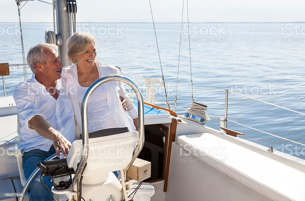 Happy Senior Couple Sailing Yacht or Sail Boat stock photo