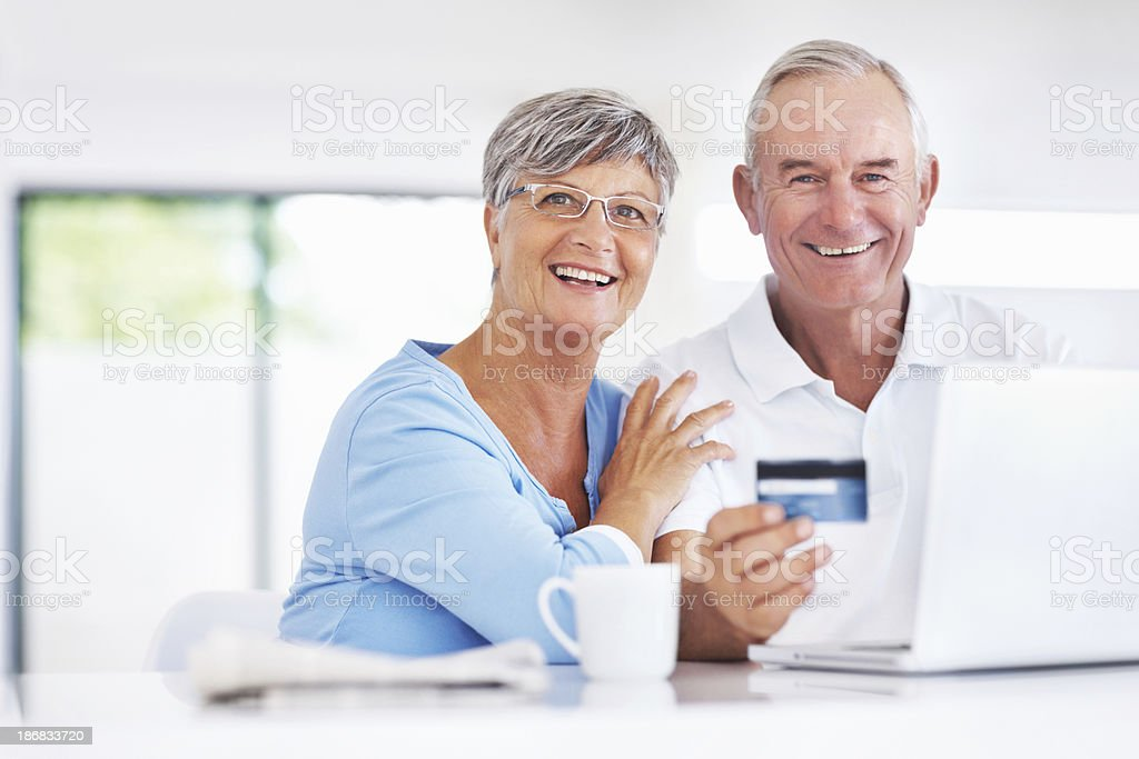 Happy senior couple shopping online royalty-free stock photo