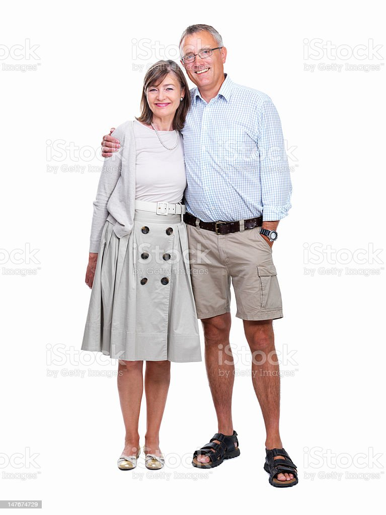 Happy senior couple standing together against white background royalty-free stock photo