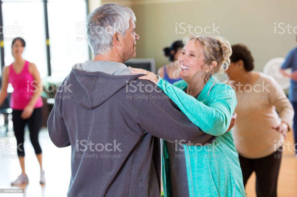 Happy senior couple take ballroom dancing lessons stock photo