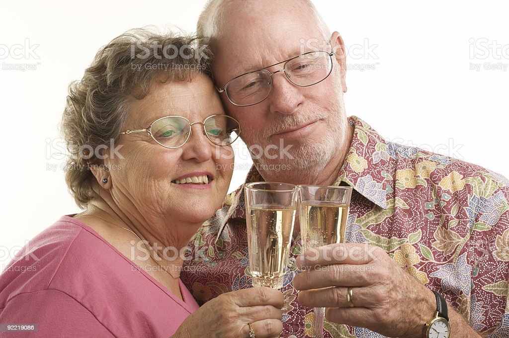 Happy Senior Couple Toasting royalty-free stock photo