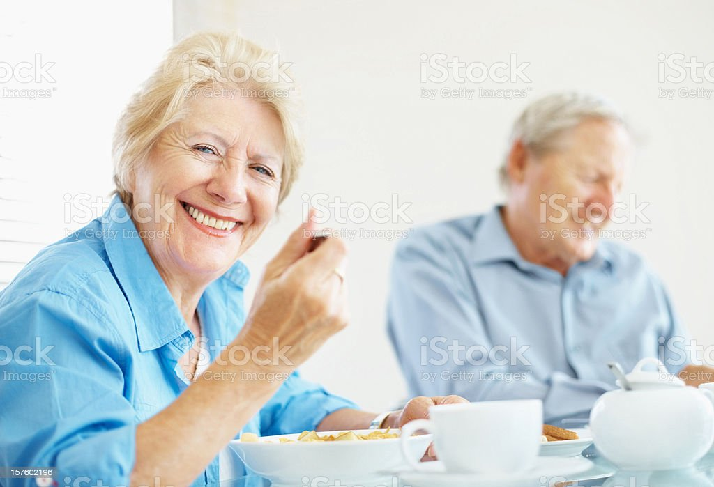Happy senior couple together having breakfast in the morning royalty-free stock photo