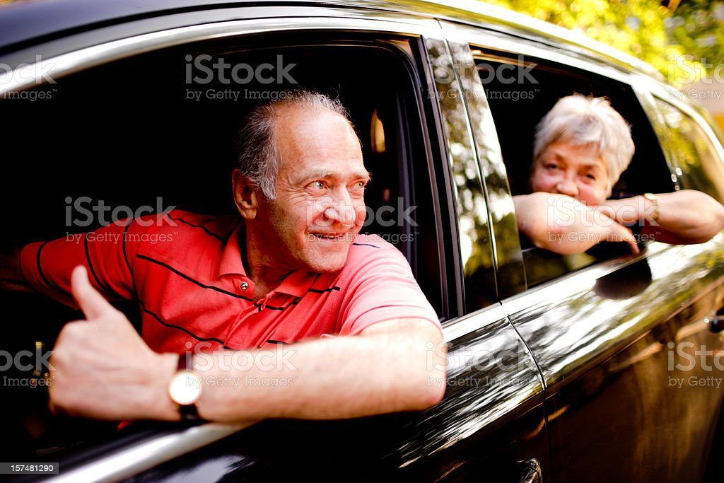 Happy Senior Couple travelling in their car royalty-free stock photo