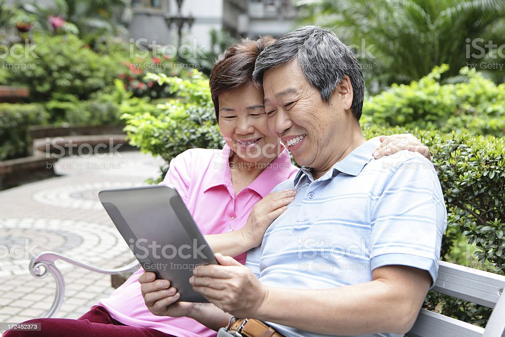 happy Senior couple using tablet pc royalty-free stock photo