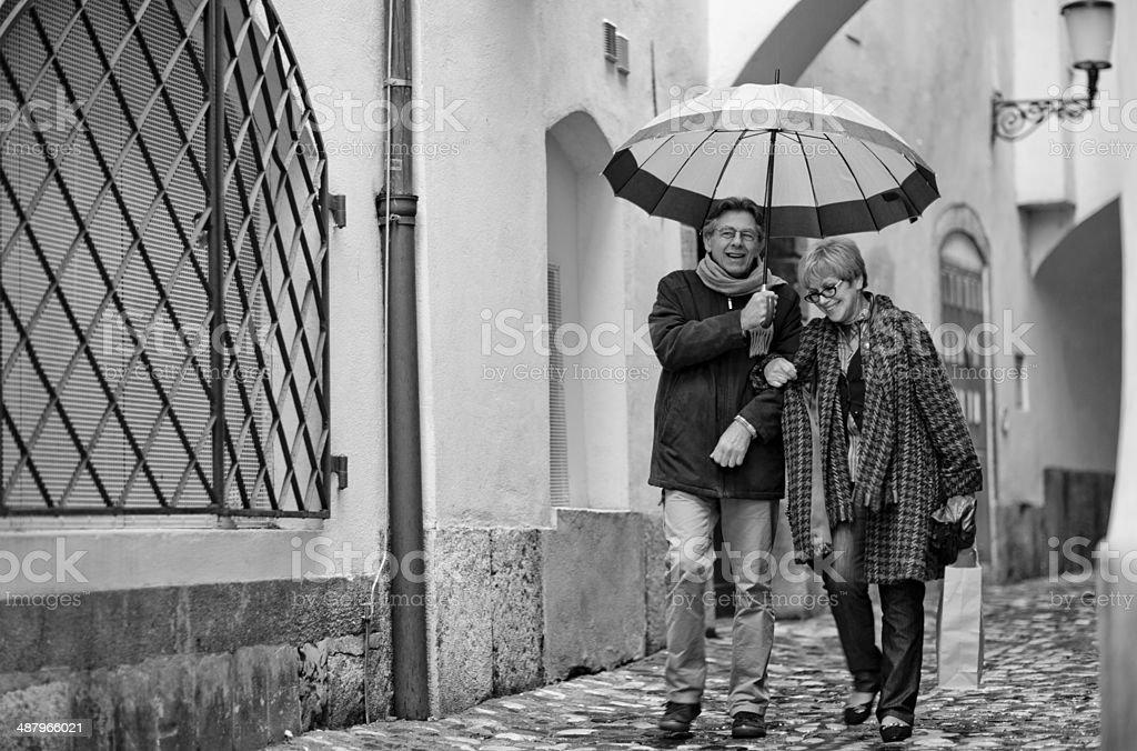 Happy Senior couple walking on the street stock photo