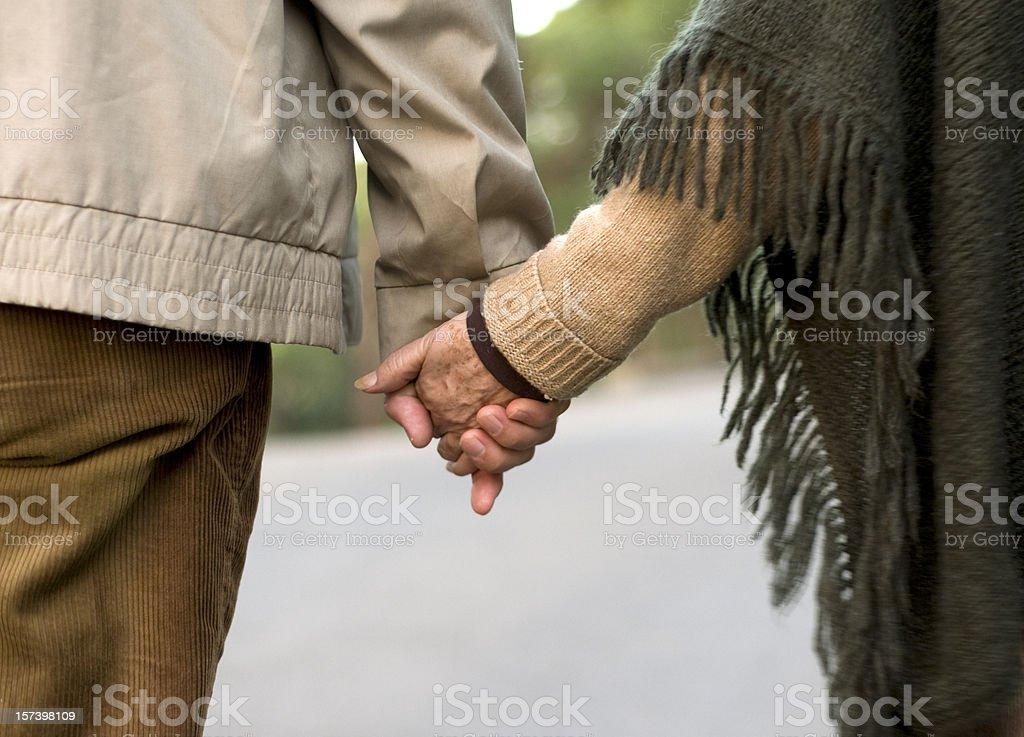 happy senior couple walking on the way royalty-free stock photo
