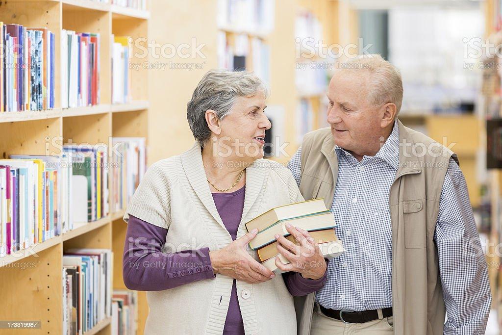 Happy senior couple with books royalty-free stock photo