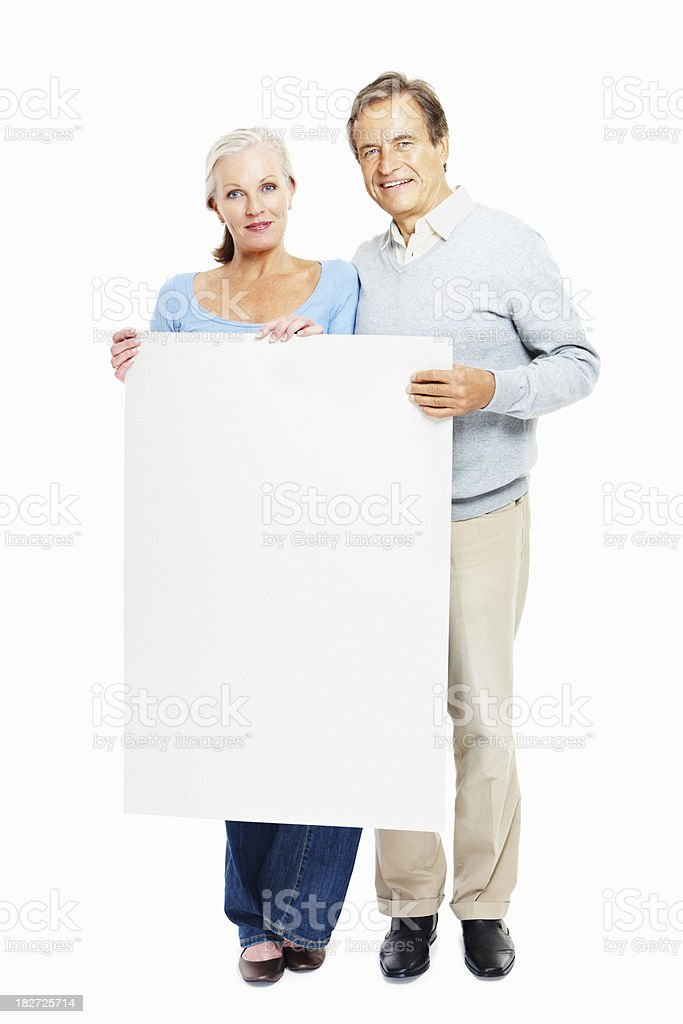 Happy senior couple with empty billboard on white royalty-free stock photo