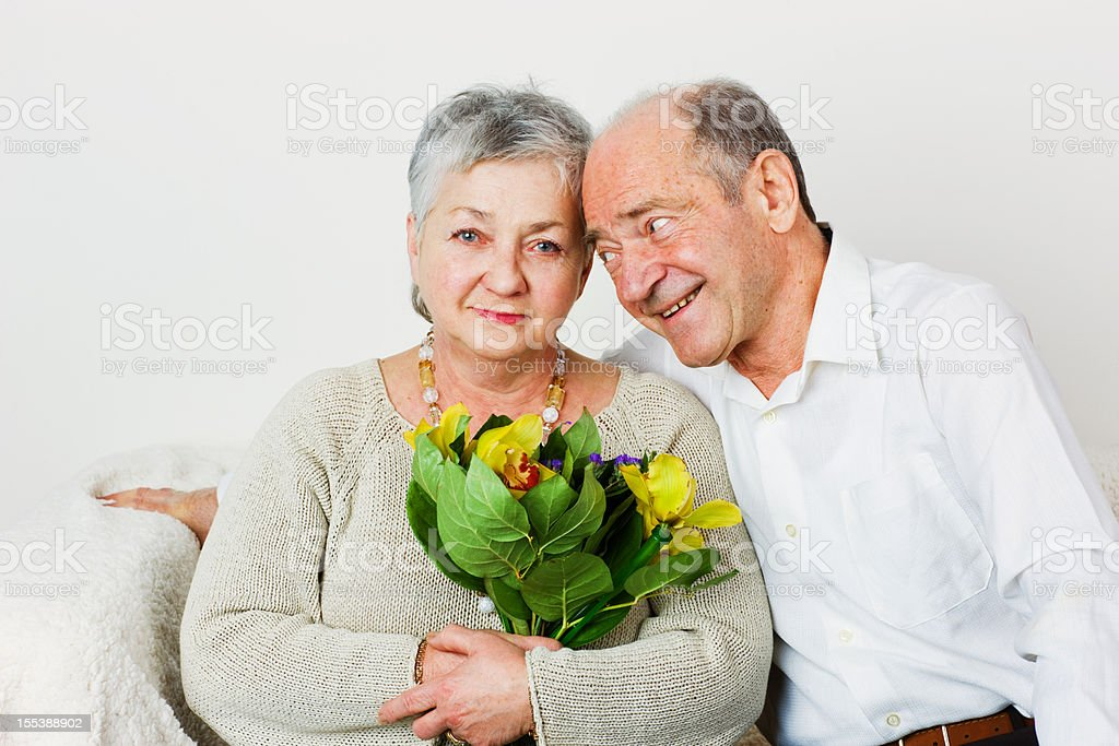 Happy Senior Couple with flowers royalty-free stock photo