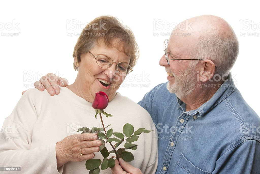 Happy Senior Couple with Red Rose royalty-free stock photo