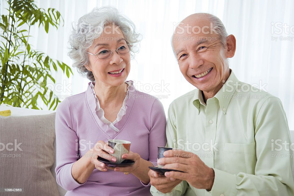 Happy Senior Couple with Tea royalty-free stock photo