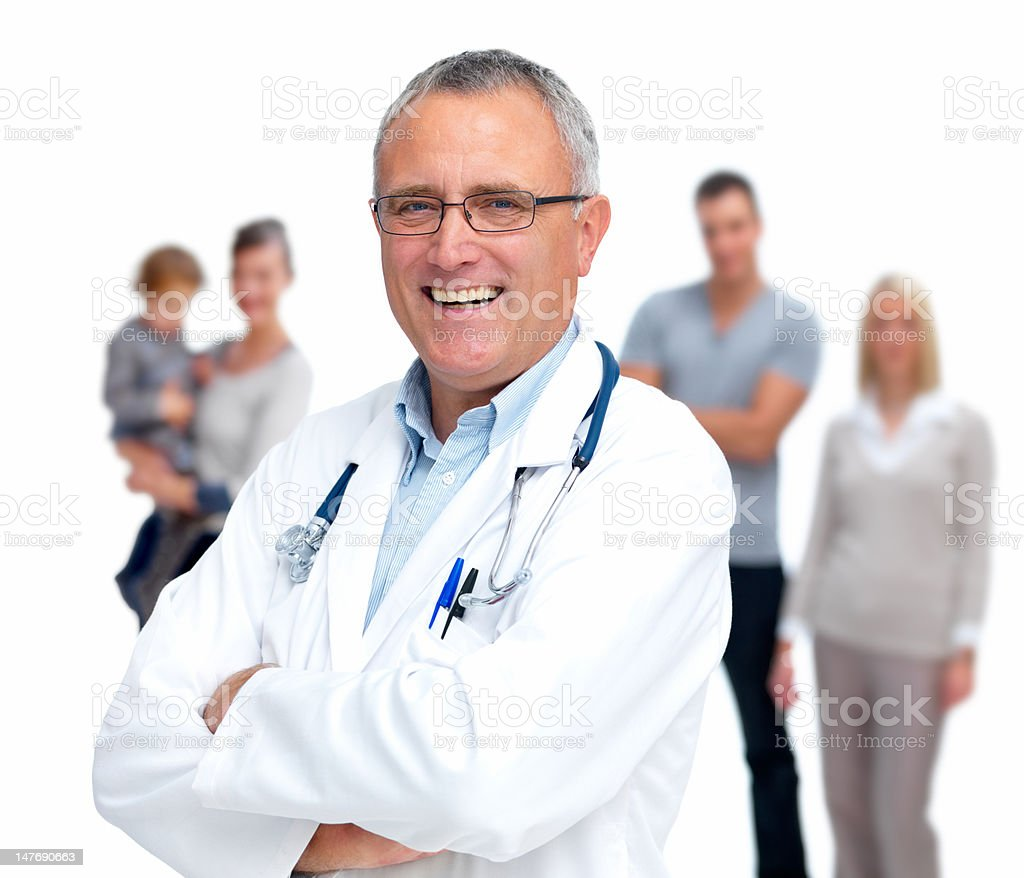 Happy senior doctor with family standing in background royalty-free stock photo