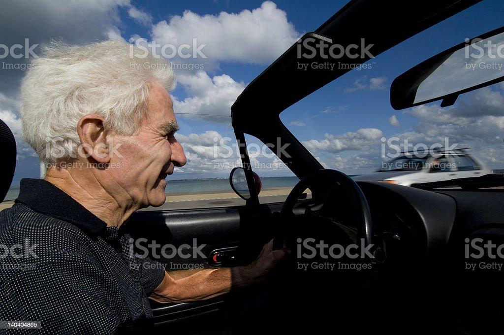 Happy senior driving royalty-free stock photo