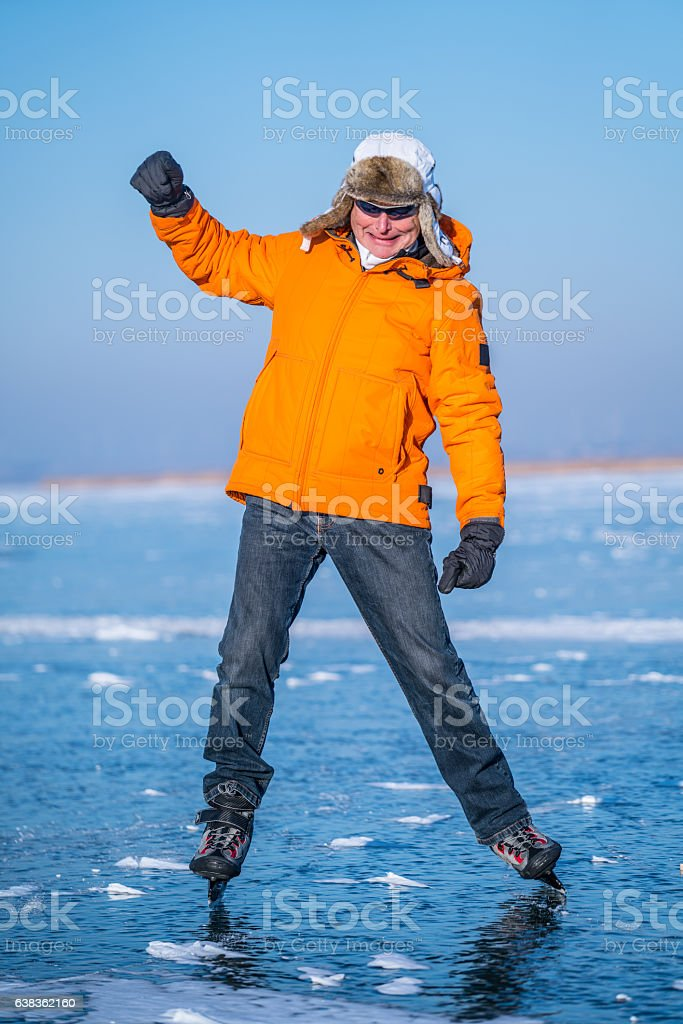 happy senior ice skater stock photo