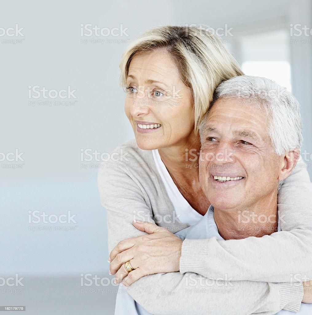 Happy senior lady embracing her husband stock photo