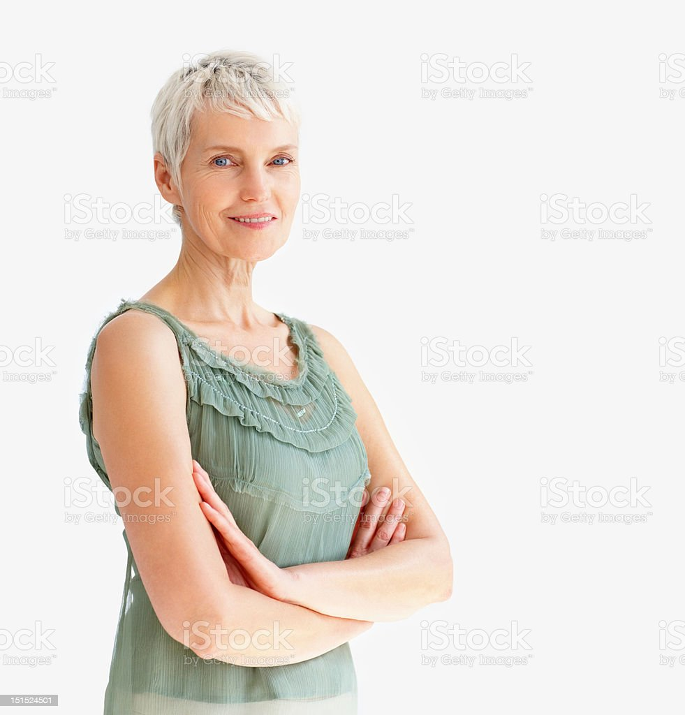 Happy senior lady with her arms crossed stock photo