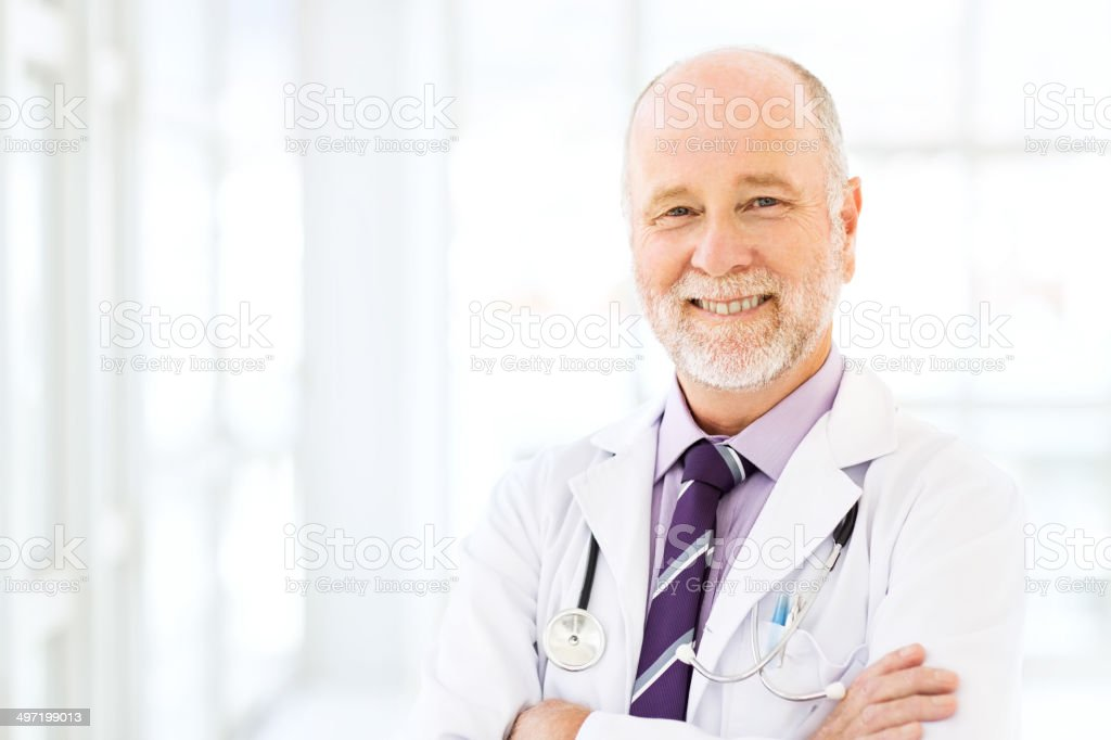 Happy Senior Male Doctor stock photo