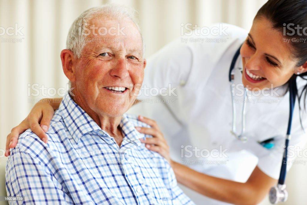 Happy senior man and doctor stock photo