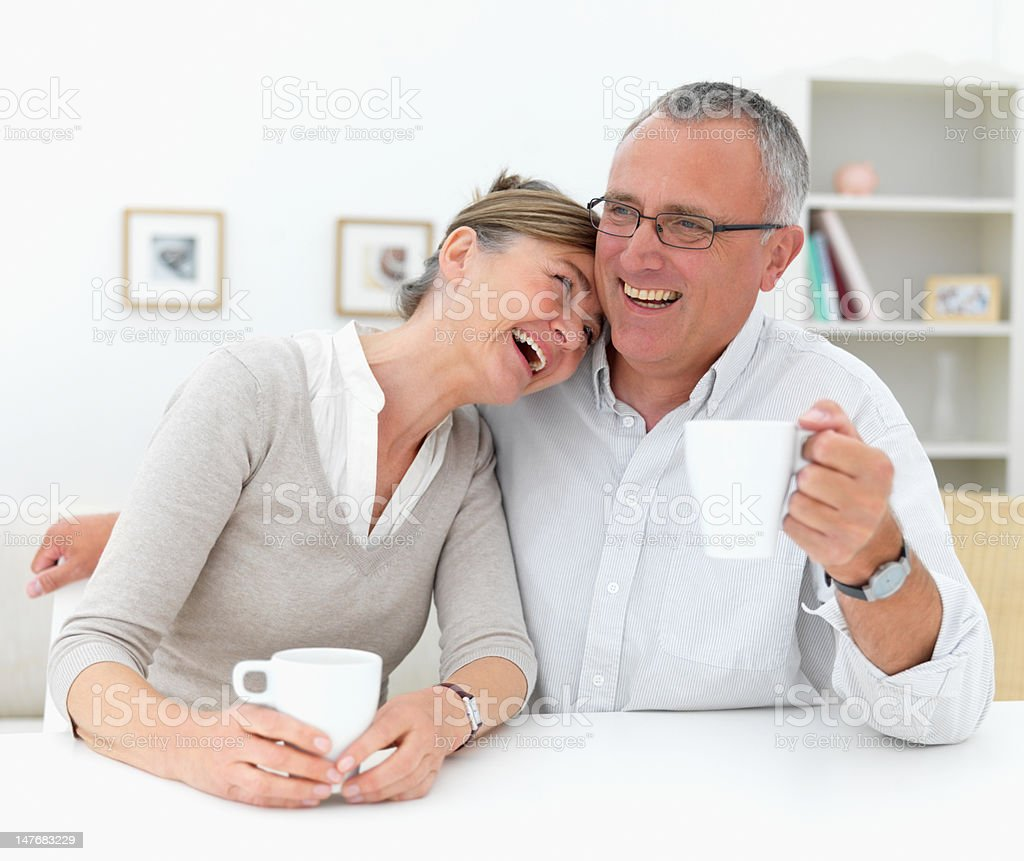 Happy senior man and woman holding cup of coffee royalty-free stock photo