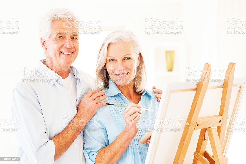 Happy Senior Man And Woman Painting royalty-free stock photo