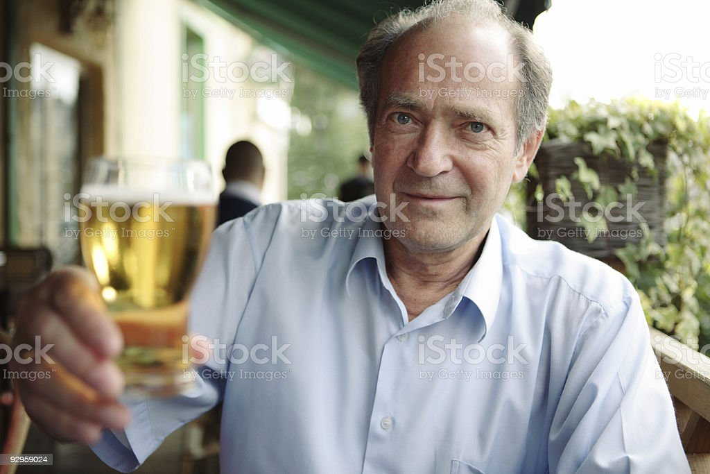 Happy Senior Man drinking beer royalty-free stock photo