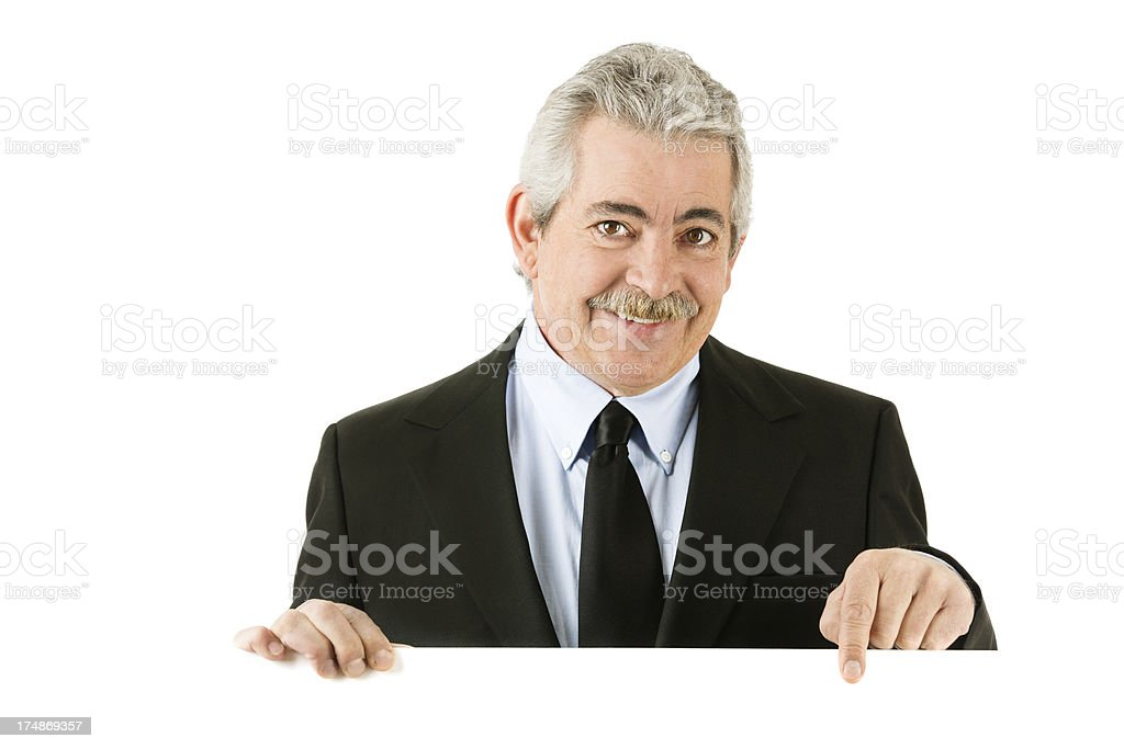Happy senior man holding a blank sign siolated on white royalty-free stock photo
