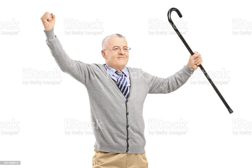 Happy senior man holding a cane and gesturing happiness royalty-free stock photo