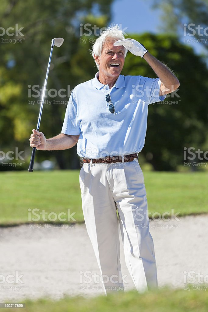 Happy Senior Man Playing Golf In Bunker royalty-free stock photo