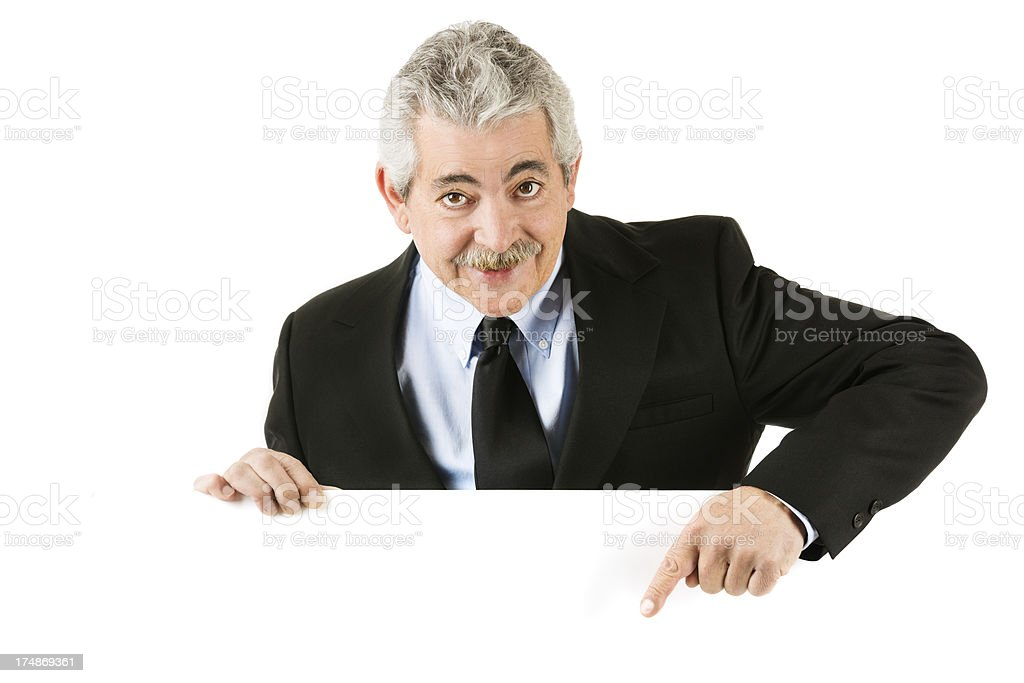 Happy senior man pointing to blank sign isolated on white royalty-free stock photo
