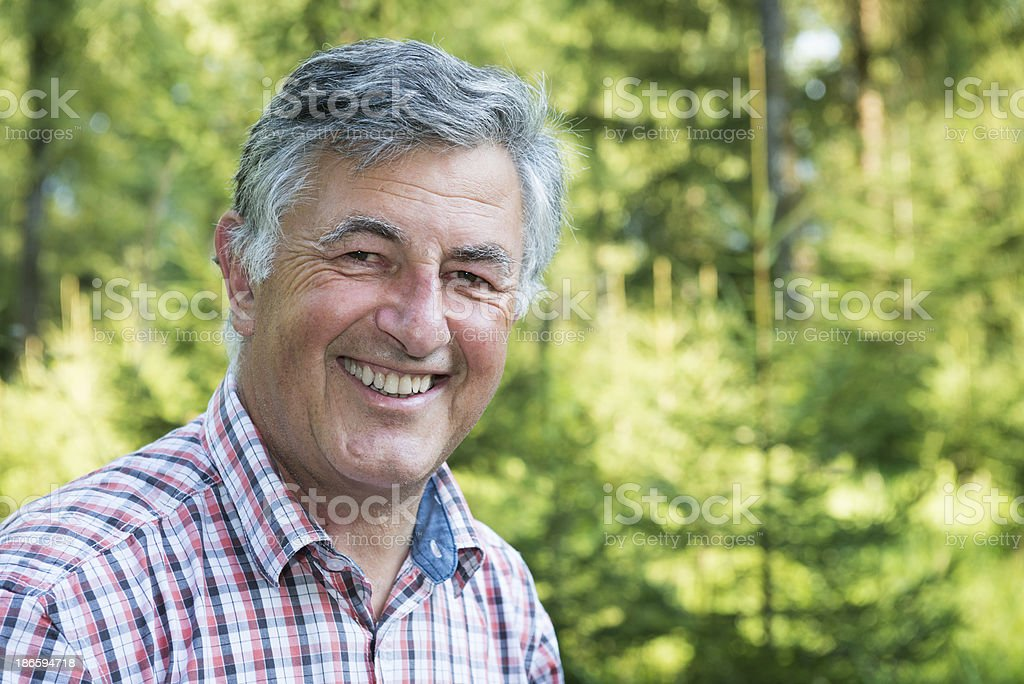 happy senior man smiling at camera royalty-free stock photo