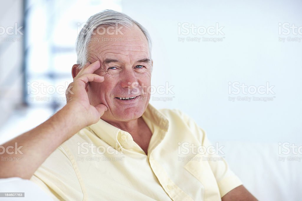 Happy senior man smiling at home stock photo